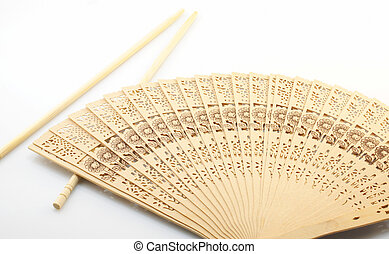 Chinese Culture - Culture of China, sticks and fan on a...