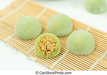 Chinese dessert mochi with ground peanut sugar filling