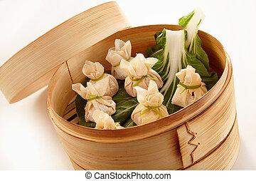 Chinese dim sum dumplings in bamboo cooker