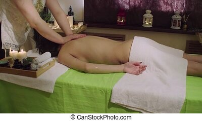 Chinese doctor doing hand massage to a young woman