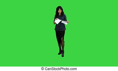 Chinese doctor talking to camera on a Green Screen, Chroma Key