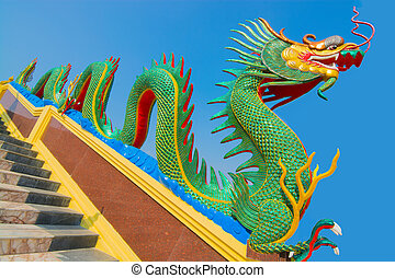 Temple - Chinese dragon guardian on stair way of Wat...