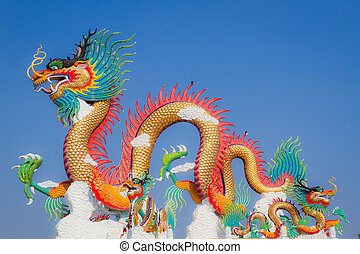 Chinese dragon statue with two small birds on its back