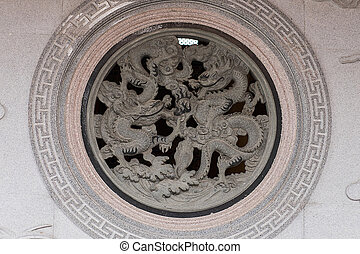 Chinese dragons carved on stone wall
