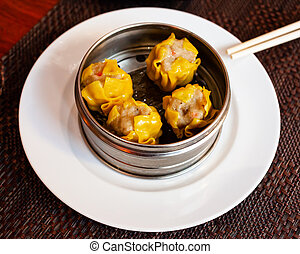 Chinese dumpling shumai on a white plate
