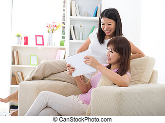 chinese female friends having a good time in living room