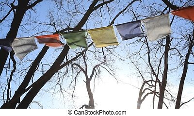 Chinese flags with prayers blowing in the wind