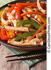 Chinese food: chicken with vegetables closeup vertical