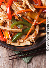 Chinese food: chicken with vegetables vertical top view