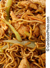 Chinese food. Noodles with chicken and vegetables