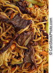 Chinese food. Noodles with veal and vegetables