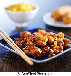 chinese food - orange chicken on blue plate