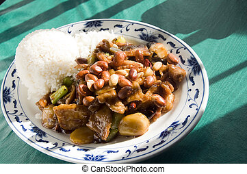 Chinese food roast pork hot pepper sauce and peanuts
