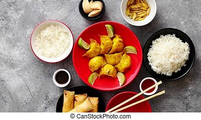 Chinese food set on stone table - Top view of Chinese food...