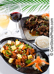 chinese food with sweet and sour pork and grilled beef rib...