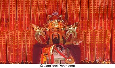 Chinese God sculpture of wealth,Red sign make wish.