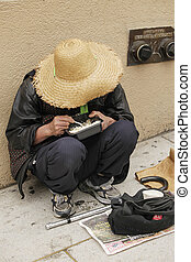 Chinese homeless woman eats in the streets of San Francisco