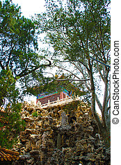 Chinese house on stone.