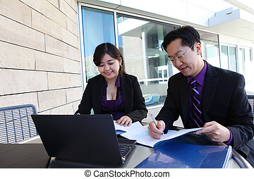 Chinese Man and Woman on Computer