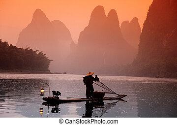 Chinese man fishing with cormorants birds, Yangshuo, Guangxi...