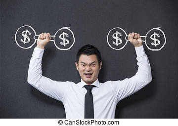 Chinese man lifting dumb bell weights with dollar sign on...