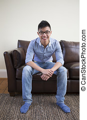 Chinese man relaxing at home. - Portrait of a trendy Asian...