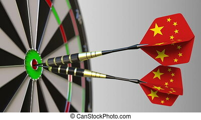 Chinese national achievement. Flags of China on darts hitting bullseye. Conceptual 3D animation