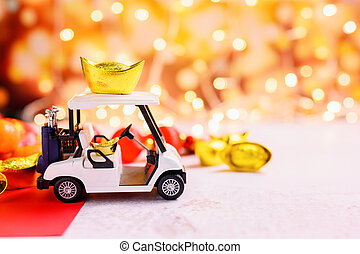 Chinese New Year, Golf car with China gold ingots, Traditional Asian style (Foreign text means blessing and lucky)