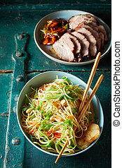 Chinese Noodle Bowl with Chopsticks and Roast Pork