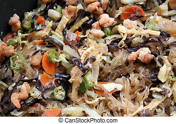 Chinese noodles with meat and vegetables traditional cuisine