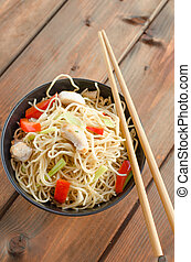 Chinese noodles, fast but delicious food with chopsticks