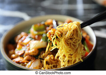 Chinese noodles with chicken and peanuts - Chinese cuisine food