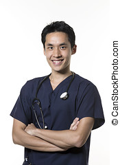 Portrait of a Male Asian nurse wearing dark blue Scrubs. Isolated on white background.