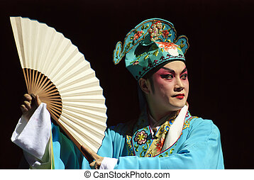 chinese opera actor performs on stage.