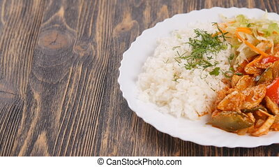 Chinese or thai rice topped with chiken