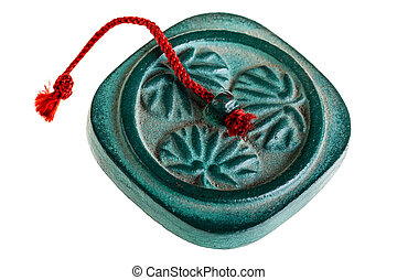 a chinese paperweight souvenir isolated over a white background
