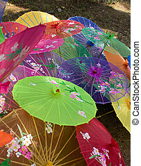 Top view of colorful Chinese silk shade parasols