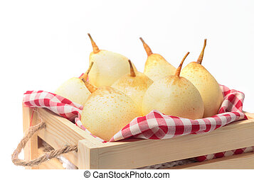 Chinese pears in wooden box on white background