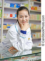 Chinese pharmacy chemist woman in china drugstore