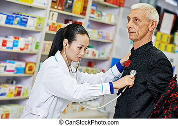 Chinese pharmacy woman with patient