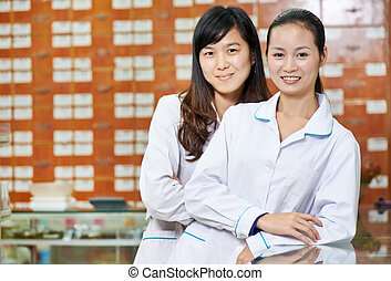 Chinese pharmacy worker in china drugstore