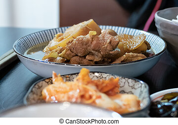 Chinese pork dish on table with side dishes - Chinese style ...
