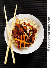 Chinese pork with peanuts served with rice
