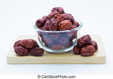 Chinese red dry jujube fruit on white