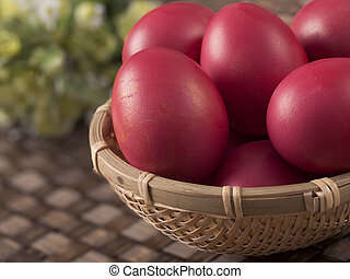 close up of a basket of chinese baby first birthday red eggs