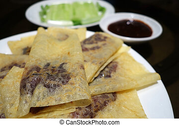 Chinese roast duck wapped in pancakes