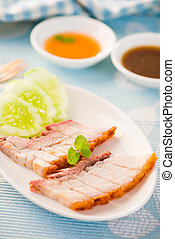 Chinese roasted pork served with soy and hoisin sauce