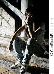 Chinese sad girl under shadow