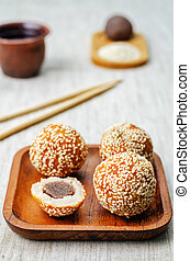 Chinese sesame balls with sweet red bean paste on a light...