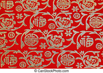 Chinese shiny ornament on red fabric - flowers and characters